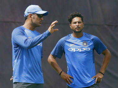 Mahendra Singh Dhoni, left, chats with spin bowler Kuldeep Yadav during a practice session ahead of their third one-day international cricket match against Sri Lanka in Pallekele, Sri Lanka, Saturday, Aug. 26, 2017. AP
