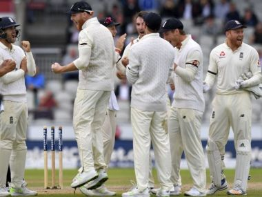 England celebrate as South Africa's Temba Bavuma is given out, on review off the bowling of England's Toby Roland-Jones, during day four of the Fourth Test at Emirates Old Trafford in Manchester, England, Monday Aug. 7, 2017. (Anthony Devlin/PA via AP)