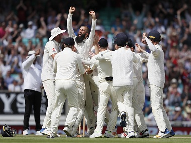 Moeen Ali is lifted by his team mates after his hat-trick. AP