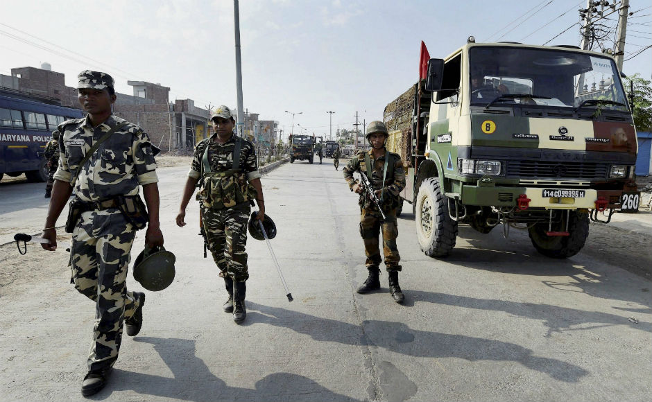 Curfew continues in parts of Punjab and Haryana; army conducts flag march
