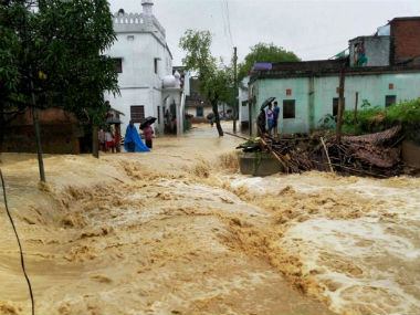 West Bengal floods People return to their homes as situation improves train tracks still inundated