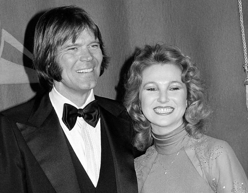 Country singers Glen Campbell and Tanya Tucker, engaged to one another, are shown at the Grammy Awards in Los Angeles, Ca., on Feb. 15, 1979. (AP Photo)