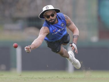 India's cricket captain Virat Kohli dives to catch a ball during a training session ahead of their second test cricket match with Sri Lanka in Colombo, Sri Lanka, Tuesday, Aug. 1, 2017. (AP Photo/Eranga Jayawardena)