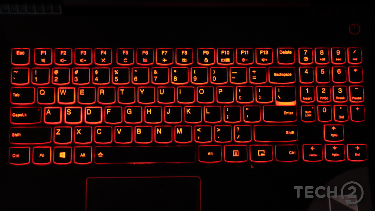 The keyboard is backlit in red. Note the unusual layout of the numpad