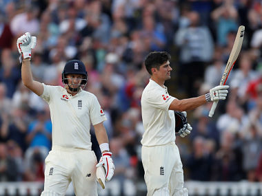 Cricket - England vs West Indies - First Test - Birmingham, Britain - August 17, 2017 England's Alastair Cook celebrates scoring his century with Joe Root Action Images via Reuters/Paul Childs - RTS1C7JF