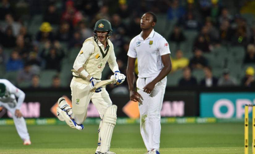 Australia's Mitchell Starc collects a run as South African paceman Kagiso Rabada looks on. AFP
