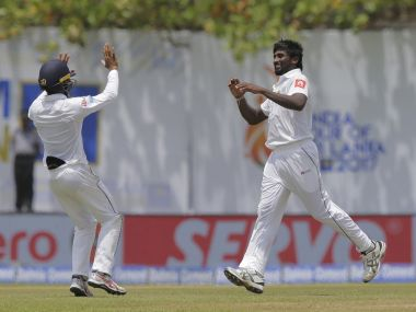 Sri Lanka's Nuwan Pradeep, center, celebrates the dismissal of India's Ravichandran Ashwin, right, during the second day's play of the first test cricket match between India and Sri Lanka in Galle, Sri Lanka, Thursday, July 27, 2017. (AP Photo/Eranga Jayawardena)