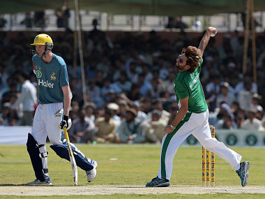 Pakistan XI bowler Shahid Afridi delivers the ball next in their match against UK Media XI. AFP