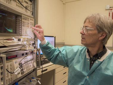 NIST physicist Ward Johnson observes signals generated by bacteria coating quartz crystals. NIST