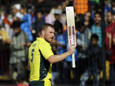 Australia cricket player Aaron Finch shows his bat on his way to the pavilion after scoring hundred during the third one-day international cricket match between India and Australia in Indore, India, Sunday, Sept. 24, 2017. (AP Photo/Rajanish Kakade)