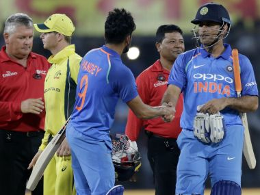 MS Dhoni celebrates with Manish Pandey after India won the third ODI against Australia. AP