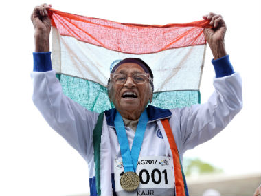 101-year-old Man Kaur from India celebrates after competing in the 100m sprint in the 100+ age category at the World Masters Games at Trusts Arena in Auckland. AFP