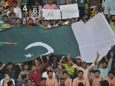 Fans cheer at the start of the first T20I between Pakistan and World XI in Lahore on Tuesday. AFP