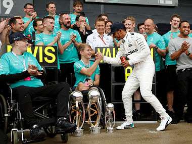 F1 - Formula One - British Grand Prix 2017 - Silverstone, Britain - July 16, 2017 Mercedes' Lewis Hamilton celebrates his win with Billy Monger REUTERS/Andrew Boyers - RC117F6919A0