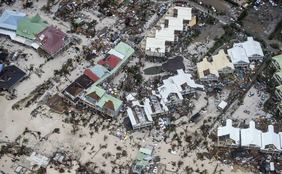 Hurricane Irma's deadly passage in Caribbean kills 14; category 5 storm now heads to Florida