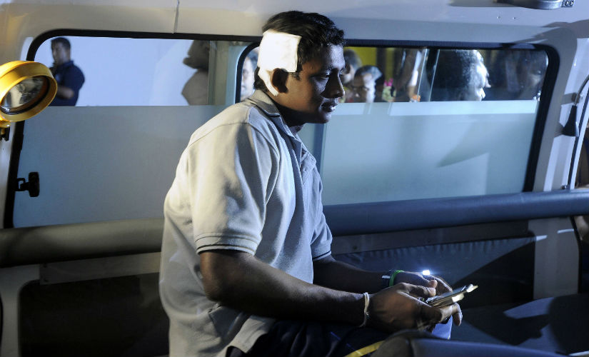 Sri Lanka's Ajantha Mendis sits inside an ambulance shortly after his return to Colombo, following the team's escape from a terrorist attack outside Gaddafi Stadium in Lahore in 2009. AFP