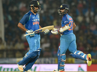 Rohit Sharma and Ajinkya Rahane (R) run between the wickets during the fifth one-day international against Australia. AFP