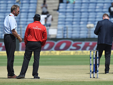 ICC match referee Chris Broad (L) inspects the pitch ahead of the 2nd ODI between India and New Zealand in Pune. AFP