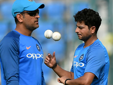 Mahendra Singh Dhoni (L) and Kuldeep Yadav attend the team's practice session at the Green Park Cricket Stadium in Kanpur. AFP