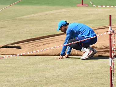 MS Dhoni inspects the pitch during a training session ahead of the 2nd ODI between India and New Zealand in Pune. AFP