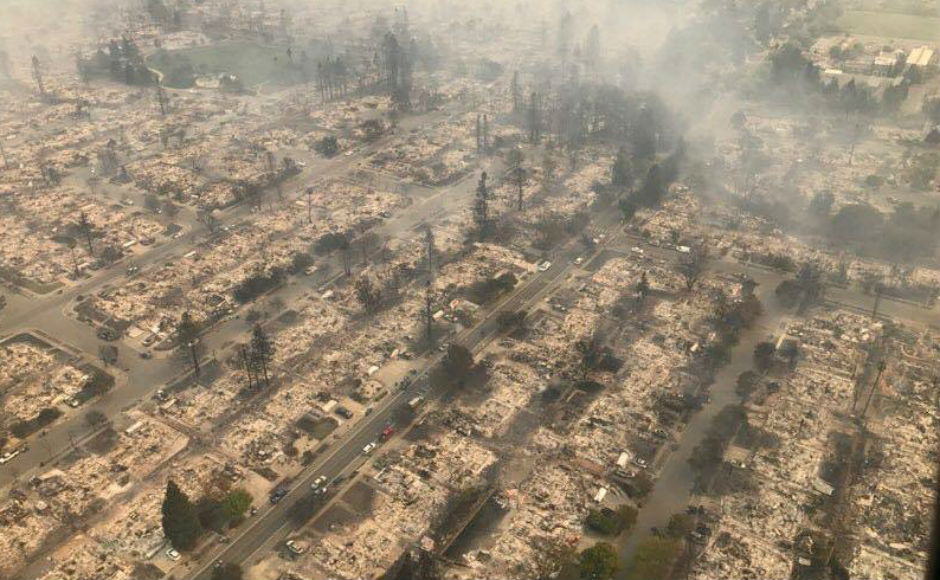 Thousands flee as deadly wildfire rages in California; 15 killed; 1,500 homes destroyed