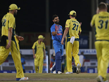Australian cricketers congratulate Indian cricket captain Virat Kohli after India beat Australia in the their first T20 cricket match in Ranchi. AP