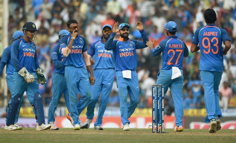 Indian cricket captain Virat Kohli (C) celebrates with teammates during the fifth ODI against Australia. AFP