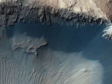 NASA's Mars Reconnaisance Orbiter (MRO) shows one possible place where sand grains are being produced. NASA