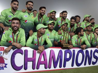 Pakistani cricket team players pose with the T20 series winning trophy during a presentation ceremony after the third Twenty20 international match between Pakistan and Sri Lanka at the Gaddafi stadium in Lahore, Pakistan, Sunday, Oct. 29, 2017. (AP Photo/K.M. Chaudary)