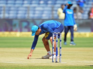 MS Dhoni inspects the pitch ahead of the 2nd ODI cricket match against New Zealand in Pune. PTI