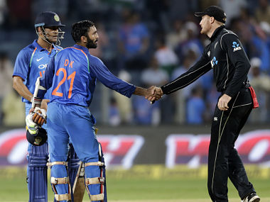 New Zealand's Martin Guptill congratulates India's Dinesh Karthik after India won the second ODI by six wickets in Pune. AP