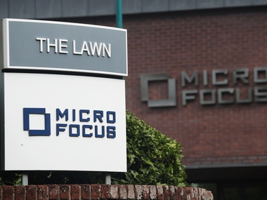 Signs stand outside the offices of Micro Focus. Reuters