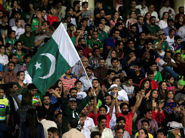 File image of a spectator waving Pakistan's national flag of Pakistan during World XI series in Lahore. Reuters