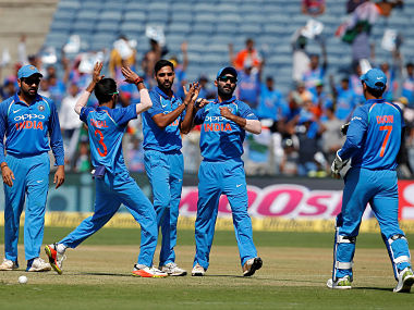 Cricket - India v New Zealand - Second One Day International Match - Pune, India, October 25, 2017 - India's Bhuvneshwar Kumar (C) celebrates with his teammates after taking the wicket of New Zealand's Martin Guptill. REUTERS/Amit Dave - RC166D22CA10
