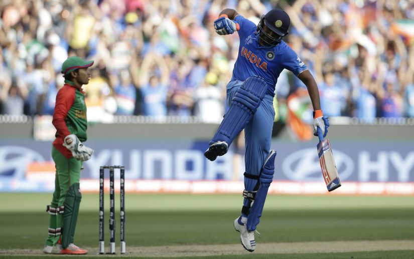 File photo of Rohit Sharma celebrating after reaching his century during the World Cup quarter-final match against Bangladesh. Reuters