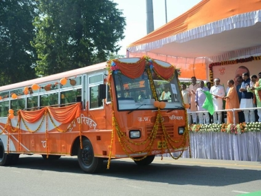 Painting UP saffron: Yogi Adityanath flags off saffron buses, continues imprinting BJP colour in state
