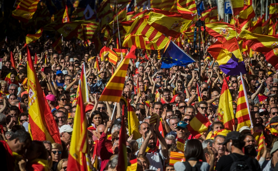 Pro-unity protesters gather in Barcelona two days after Catalonia gains 'independence'