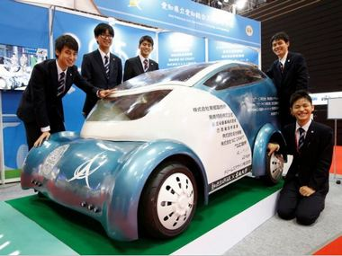 Students from Aichi Highschool of Technology and Engineering pose next to their developed electric vehicle named Collapse. Reuters