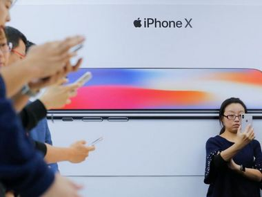 Attendees use new iPhone X during a presentation for the media in Beijing. Reuters