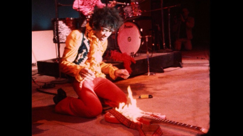Jimi Hendrix sets his guitar on fire. Still from Monterey Pop