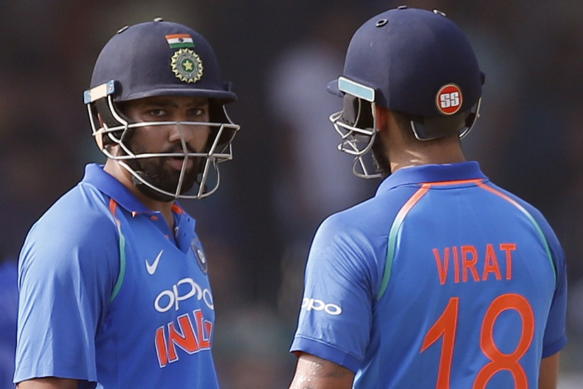 Rohit Sharma interacts with captain Virat Kohli during their double-century stand. AP