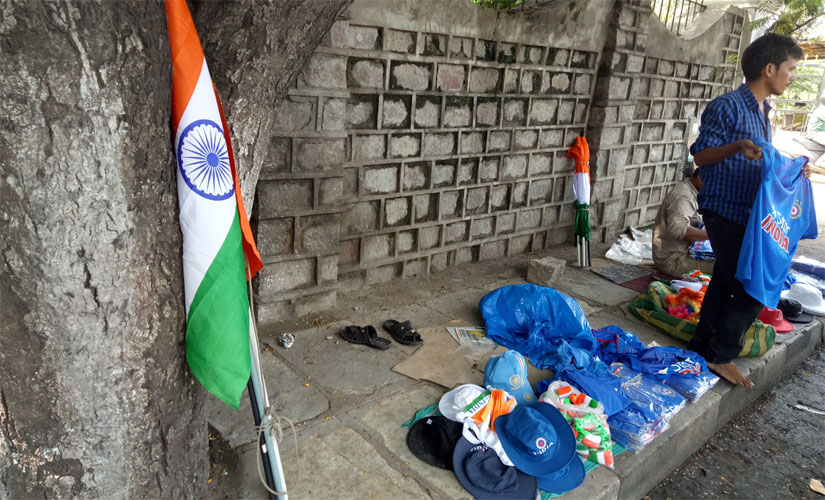 People were seen stocking up on Kohli and Dhoni jerseys, India flags, caps and head bands all in preparation for D-day. Firstpost/ Debdutta Bhattacharjee