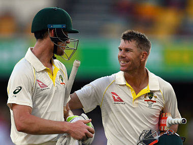 Australian openers David Warner (R) and Cameron Bancroft guided hosts to a 10-wicket win on Monday. AFP