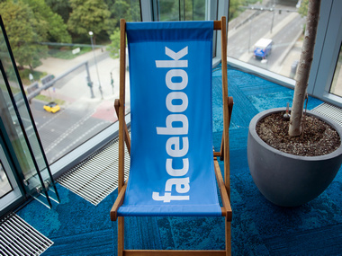 A picture shows the Facebook logo on a chair in its office. Reuters