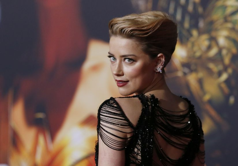'Justice League' star Amber Heard was told coming out would 'throw away her career'