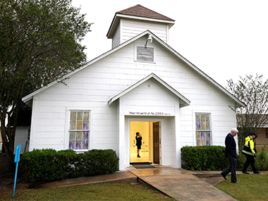 A member of the media walks inside the First Baptist Church of Sutherland Springs where 26 people were killed. Reuters