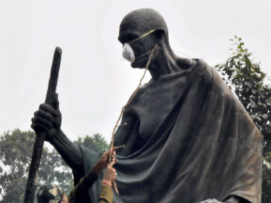 Delhi air pollution: MLAs tie protective masks on Mahatma Gandhi's statue to protest AAP govt's inaction