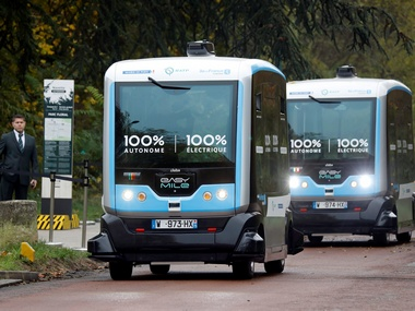 Two self-driving electric minibuses are seen on a test route in Paris. Reuters