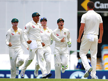 Cricket - Ashes test match - Australia v England - GABBA Ground, Brisbane, Australia, November 26, 2017. Australia's Josh Hazlewood celebrates with team mates after dismissing England's captain Joe Root during the fourth day of the first Ashes cricket test match. REUTERS/David Gray - RC16D1C95E40