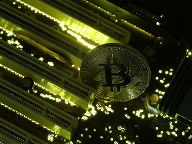 A copy of bitcoin standing on PC motherboard is seen in this illustration picture, October 26, 2017. Picture taken October 26, 2017. REUTERS/Dado Ruvic - RC1E130E5300